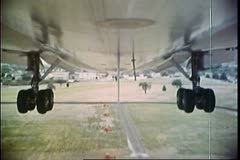 Point of view shot of undercarriage of an airplane landing on runway Stock Footage