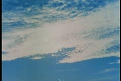 Montage of vast desert against blue sky Stock Footage