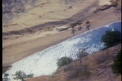aerial view of men on horses galloping alongside buffalo river in arkansas - stock footage