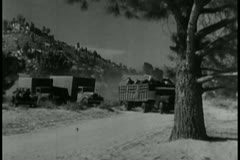 wide shot of cars overtaking trucks on a dirt road - stock footage