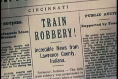 Montage of newspaper headlines of train robberies Stock Footage