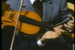 Midsection of man in suit playing violin Stock Footage