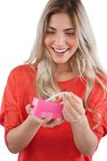 Stock Photo of Blonde woman discovering necklace in a gift box