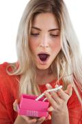 Shocked woman discovering necklace in a gift box - stock photo
