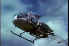 Pilot landing helicopter at heliport Stock Footage