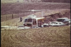 Wide shot of helicopter taking off from field Stock Footage