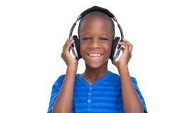 Happy little boy listening to music - stock photo