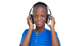 Smiling little boy listening to music Stock Photos