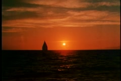 tranquil scene of boat sailing in an open ocean at sunset - stock footage