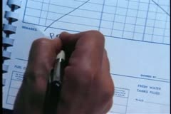 Close-up of man writing food and progress report in journal Stock Footage