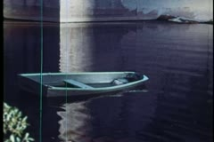 A row boat sinking in water Stock Footage