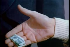 Close-up of man slipping doorman $50 during handshake Stock Footage