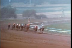 Two race horses breaking away from the pack to take the lead Stock Footage