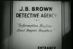 Close-up of  sign on detective's office door Stock Footage