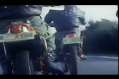 Rear view of bikers riding motorcycles on country road Stock Footage
