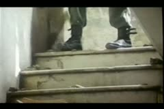 low section of man in combat boots walking down stairs - stock footage