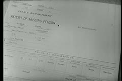 Close-up of d.o.a. stamp on missing person's report Stock Footage