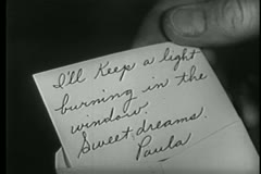 close-up of  man holding handwritten note - stock footage