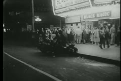 Point of view shot of motorcycle police in front of theater Stock Footage