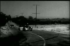 Police cars veering off country road Stock Footage