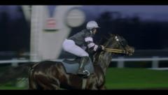 JOCKEY ON HORSE - NIGHT # 2 Stock Footage