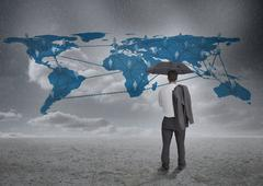 Thinking businessman viewing world map Stock Photos
