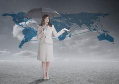 Businesswoman in front of blue map Stock Photos