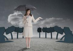 Businesswoman in front of signs - stock photo