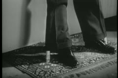 Rug pulled from under feet of dangling body Stock Footage