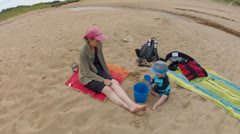 Mother and her baby boy at the beach Stock Footage