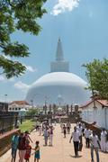 pilgrims near white sacred stupa, anuradhapura, sri lanka - stock photo