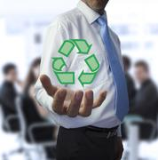 Stock Photo of Businessman holding the recycling symbol