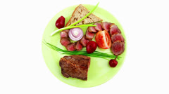 Meat food : roast red meat slices served on green plate Stock Footage