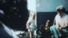 Boy Playing With Garden Hose-1963 Vintage 8mm film Stock Footage