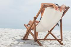 Woman lying on her deck chair Stock Photos