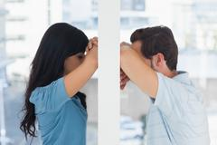 Depressed couple divided Stock Photos