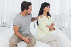 Woman sulking while her boyfriend is trying to make up - stock photo