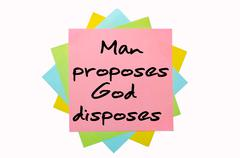 "proverb ""man proposes, god disposes"" written on bunch of sticky notes - stock illustration"