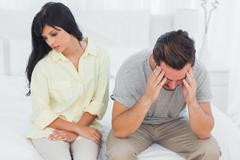 Woman sulking with boyfriend looking down during a fight - stock photo
