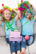Stock Photo of Twins playing with confetti during their birthday