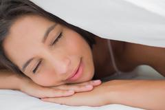 Portrait of an beautiful woman resting - stock photo