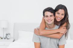 Stock Photo of Woman embracing her partner