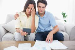Anxious couple doing their accounts - stock photo