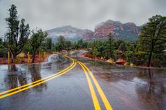 road through red rocks - stock photo