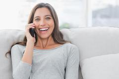Stock Photo of Portrait of a woman having a phone conversation