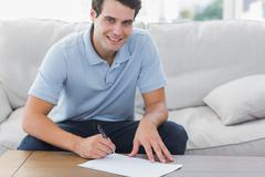 Portrait of a man writing on a paper Stock Photos