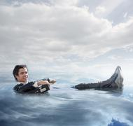 Businessman in the water Stock Photos