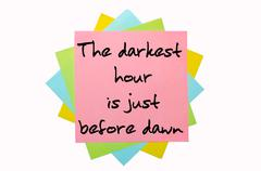 "Stock Illustration of proverb "" the darkest hour is just before dawn "" written on bunch of sticky n"