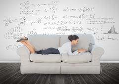 Elegant businesswoman lying on a couch Stock Photos