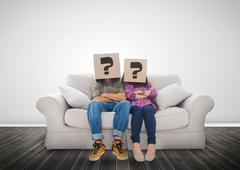 Stock Photo of Funny couple wearing boxes with question mark on their head